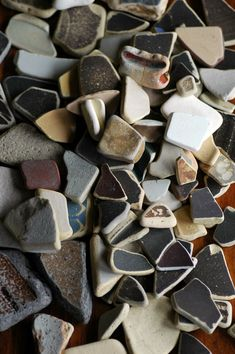 Earthenware, pottery,  and old porcelain 'sea glass' ~~~~~~~ hard to find but a treasure when I find it during my beach walks :)