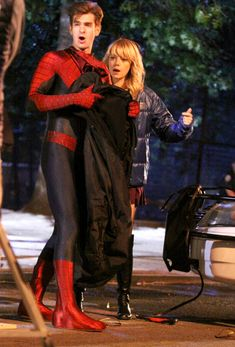 Emma Stone and Andrew Garfield film for 'The Amazing Spiderman 2' at Chinatown in New York City. (June 4, 2013)