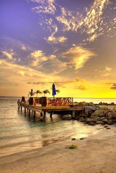 Reggae Beach pier on the Caribbean island of St. Kitts.  ASPEN CREEK TRAVEL - karen@aspencreektravel.com