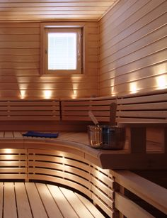 Finnish sauna with curved bench  Digging that Sunburst design on the benches and the curved edges!