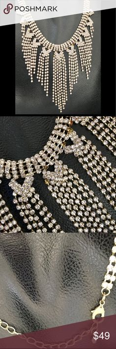 Vintage Old Hollywood Glam Rhinestone Necklace Make a statement in this Vintage Solid Rhinestone Necklace. Fringed strands of rhinestones that are adorned in a gold tone metal. Can be adjusted to wear high on neck as choker or dropped lower. See pic. Just a few teeny rhinestones missing. Can't even notice if you don't know what you're looking for. Jewelry Necklaces