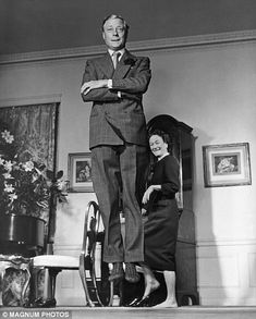 In another picture, the Duchess watches on grinning as her husband, smartly dressed in a double-breasted suit, springs up, arms folded as if performing a Highland jig