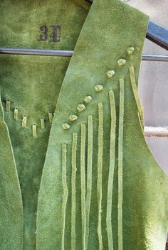 A serious boho/cowboy vest in a beautiful moss green suede. Fringe bottom, fringe front, fringe back. This thing is killer.