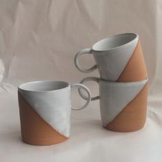 """Wheelthrown brown clay mug dipped on a diagonal in white glaze. Hand wash recommended. Approximately 3.5"""" tall and 3.5"""" across.  *In stock and ready to ship*"""