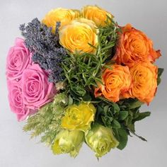 Olympic Victory Bouquet, London 2012. Consists of British grown roses, wheat,and the fragrant herbs, English lavender, rosemary and apple mint.