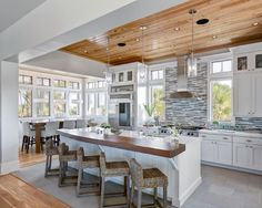 Great kitchen dining space with hardwood floors and ceiling, large windows and unique glass tile back splash, 2 tiered island with wood top counter, tiled kitchen floor oastal Va Magazine's Best Kitchen & Bathroom Remodeler #dogoodwork www.jimhicks.com