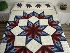Estrella. Love these colors to make the Cathedral Star Quilt (also known Log Cabin Star).  Eleanor Burns has pattern and tut for large blocks in tablecloth.