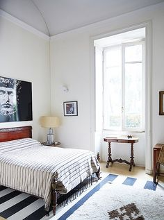 Above the guest room bed hangs a photograph by Olivier Roller of a bust of Lucius Verus, who was co-emperor of Rome with Marcus Aurelius.