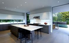 Modern Functional and Sustainable Orchard House sliding glass walls