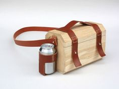 Wood Lunchbox by Niels van Eijk & Miriam van der Lubbe: With leather straps and a drink holder.
