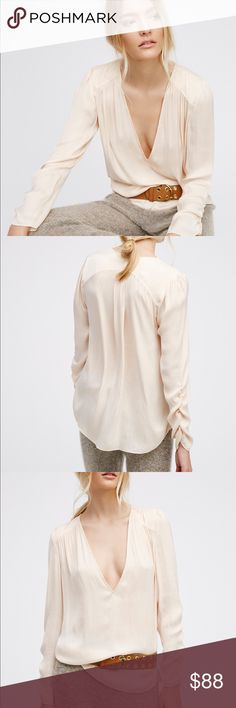 """Free People Dance Off Top Tags removed but never worn.  Cream color. Ultra silky long sleeve top with a super femme feel. Features a plunging V-neckline and sweet ruched details along the sleeves. Lightweight and semi-sheer. 100% Polyester Machine Wash Cold Import Measurements for size Small Bust: 40"""" = 101.6 cm Length: 27.75"""" = 70.49 cm Sleeve Length: 25"""" = 63.5 cm Free People Tops Blouses"""