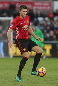 Michael Carrick of Manchester United in action during the Premier League match between Swansea City and Manchester United at the Liberty Stadium on...