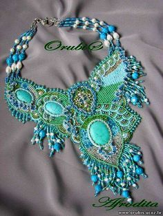 Orubis lives in Latvia and makes beautiful embroidered jewellery.