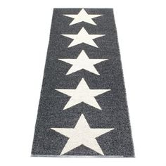 Viggo Star rug by Pappelina...love, love her rugs..woven in soft pliable plastic, the best rug choice for families with kids and dogs..looks smashing I think...and it is reversable.