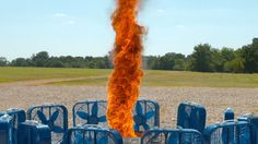 Watch Man made fire tornado, created by igniting a bucket of kerosene, surrounded by a dozen box fans on fire. Shot in super slow motion at stunning 2500fps with Phantom Flex