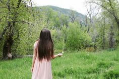 I thought this one was pretty from the shoot so I wanted to share it! :) Dandelions pink dress forest canyon long hair brown photoshoot engagements green trees magical mystery little girl
