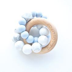 Modern baby teething with silicone beads and wood rings. Made in Canada. Stylish nordic inspired design by Loulou Lollipop. Silicone teether. Wood teether.