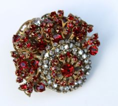 This is a signed Miriam Haskell brooch made in the classic Miriam Haskell manner. Filigree brass with gold wash wired sturdily together, adorned with prong set red and clear crystals. Miriam Haskell jewelry was worn for publicity shots, films, and personal use by movies stars Joan Crawford and Lucille Ball, as well as by Gloria Vanderbilt and the Duchess of Windsor. | eBay!