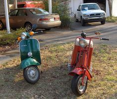 Vespa left, Cushman right. That's my vintage Toyota collection in the back ground. I don't have any 21st Century vehicles yet. The Camry, at rear left is a '99 model with alloy wheels, spoiler and a rare 5-speed manual shift. The Toyota Tacoma truck  http://choxeviet.com/cho-oto.aspx  http://choxeviet.com/toyota/-i10/vios-j190.aspx