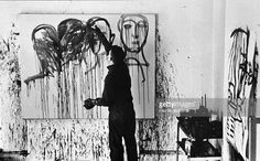 American artist Lester Johnson works on a painting in his studio on 10th Street, New York, New York, 1961.