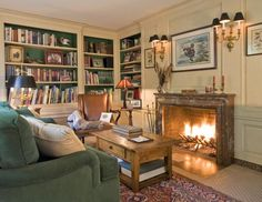 Library with creamy beige paneling and green accents - mls 3220943