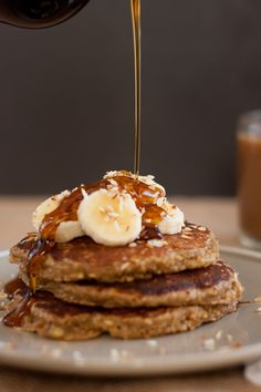 banana oat pancakes ~  3 small bananas (9.5 ounces), mashed 2 tablespoons coconut oil or butter, melted 1 tablespoon lemon juice (about 1 small lemon, juiced) 1 teaspoon honey or maple syrup 2 eggs 1 cup oat flour* 1/2 teaspoon baking soda 1/2 teaspoon salt 1/2 teaspoon ground cinnamon 1/4 teaspoon ground nutmeg