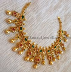 22 carat gold very unique bridal choker with flower motifs in uncut diamonds, square shaped large emeralds. Pear shaped rubies all over. ...