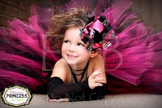 Great example of a boutique modeling shot.  The photographer took care to fluff out the tutu to it's fullest and also to place the hair accessory on the side of the model's head that was towards the camera.  She is smiling, having fun and engaged!