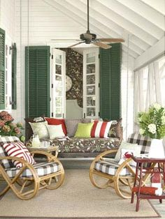 really soothing southern looking porch, love the colors and love how steep and high the ceiling is, that really makes all the difference...the steep slant really creates a haven...wouldn't it be awesome to sit here during a southern summer downpour?  yay!