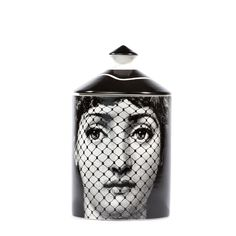 Alluring candle with lid featuring Fornasetti muse Lina Cavalieri with Italian 'mantilla' on one side and mask on another Scent: Otto Top notes: Thyme, Lavender 300g; Approximate burn time: 70 - 80 ho