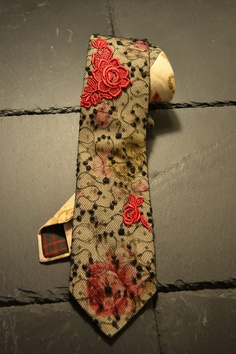 You are viewing a one of a kind handcrafted beige necktie with floral print.  The showing end is wrapped with a black lace fabric and there are appliqued two red rose embroideries on top. Both, lace fabric and embroidery are from world known manufacturers in St.Gallen, Switzerland. The lace fabric is sufficiently robust and forms a nice knot. #necktie #krawatte $184.87