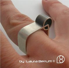 LAURA BERRUTTI - USA - Sterling Silver Ring w/Tube Crossing Through via Etsy