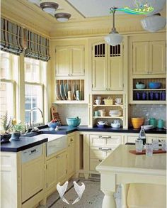 Design Ideas for a Country Farmhouse Kitchen | Quarto Knows Blog Farmhouse kitchen design idea.Light yellow cabinets, plaid blinds and colorful dishes<br> Chris Peterson, author of Kitchen Ideas You Can Use, shares insights about creating the warm, casual style of a country farmhouse kitchen.