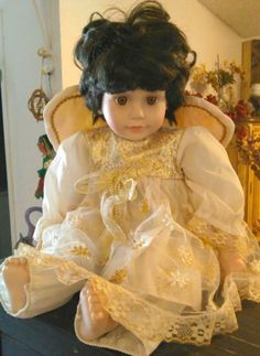 Ceramic Doll Brown hair Angel wearing Outfit and Wings numbered Babydoll