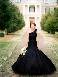 Black wedding dress and white bouquet