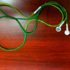 I used my old school bracelet making skills to wrap my iPhone earbuds! 💚