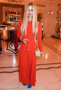 Coordinating: The model, turned heads in a sizzling red maxi dress and statement lip. Long Winter Dresses, Daily Fashion, Girl Fashion, Laura Bailey, Poppy Delevingne, Spring Looks, Classy Dress, Business Women, Style Icons