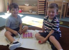 The boys are playing a memory matching game. #PreschoolMathematics