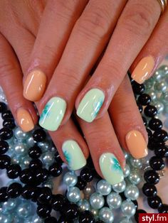 Very lush nails. Reminds us of the beach with its cool blue and warm sand shades!