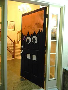 I love this door decor, another option would be green for Frankenstein