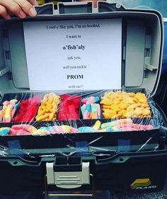 "I ran across this adorable idea on how to ask someone to prom! She filled a real tackle box with sour gummy worms,  goldfish crackers, and swedish fish. Then she wrote on the inside.. ""I reel-y like you, i'm so hooked, I want to o 'fish'aly ask you, will you tackle PROM with me?"" So cute …"