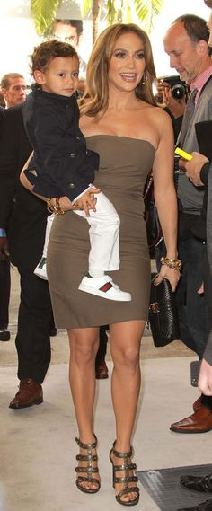 Stunning Gucci dress. Love the shoes on her son!