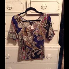 Just Cavalli top size 10 Italian size 44 which is 10 in Us. Just Cavalli Tops