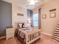 Adventure calls this adorable bedroom! Browns, blues, and wildness patterns make this perfect for the outdoorsy-type. Highland Homes' Shelby model home in Winter Haven, Florida Creative Kids Rooms, Winter Haven, Highland Homes, Bedroom Pictures, New House Plans, Florida Home, Model Homes, Home Builders, Kids Bedroom