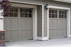 Garage doors painted same color as the house blend in