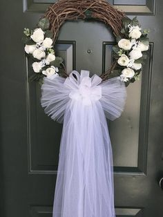 Brides Wanted! Please read below regarding shipping. Our White Rose Wedding Wreath is sophisticated and elegant! Its made with artificial white roses and babies breath with tiny cluster of white flowers as well as a soft tulle wedding veil with matching satin bow! Our wedding