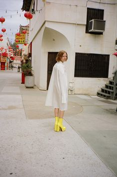 Capturing the heart and spirit of Penny Sage, French-Californian Nastassia Bruckin photographs her friend Matilde as they take a stroll through Chinatown, Los Angeles. The SS17 collection 'The Little Kicks' features vegetable dyed organic denim, a bespoke print designed by Marta Katarzyna Buda. Photographed by Nastassia Bruckin  Styled by Gina Esposito  featuring Matilde Riccardi  Hair and Makeup by Rita Lee Burton
