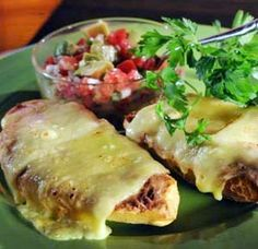 Mexican Molletes recipe ~ Inside Mexico, molletes are made using bolillos that you slice lengthwise and then top with a layer of frijoles and then some chihuahua cheese. It is then grilled in an oven until the cheese melts.