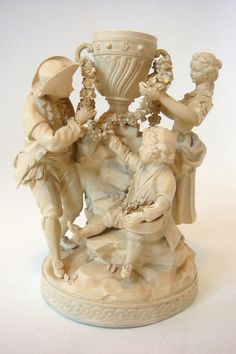 MAGNIFICENT DIHL ET GUERHARD, SEVRES BISCUIT GROUP OF FAMILY AROUND URN C1810