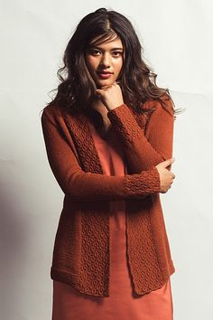 Pair this knitted cardigan with anything to add a level of class and sophistication.